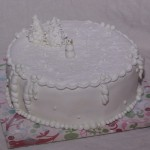 kerst taart wit met sneeuwpop van fondant