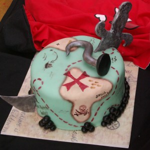 pirate cake with sword and hook