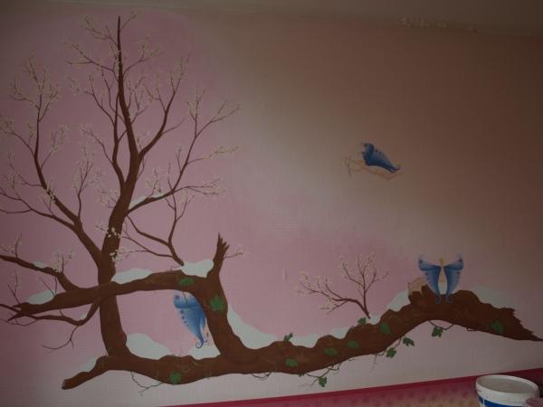 muurschildering elfjes bloesem boom winter sneeuw