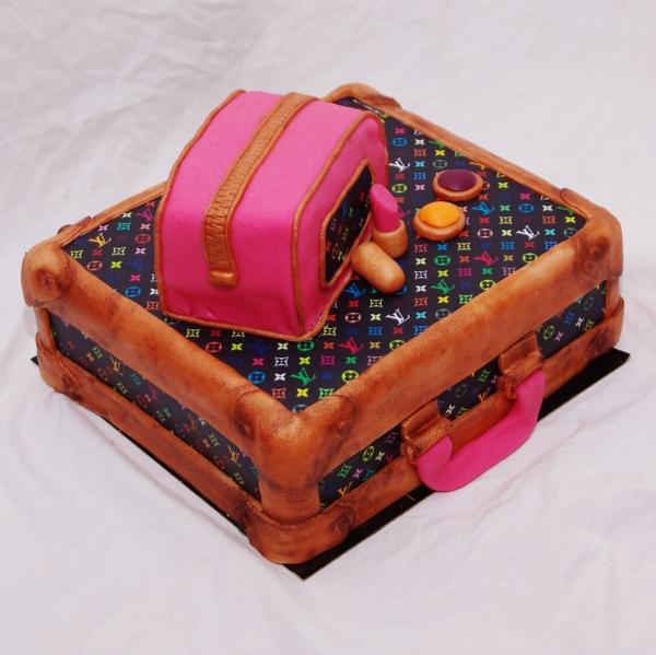 louis vuitton koffer taart voor het goede doel